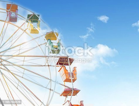 Ferris wheel with blue cloudy sky on background, summer vacation theme,  stock photo