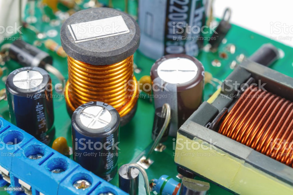 Ferrite choke and electrolytic capacitors mounted on the circuit Board stock photo