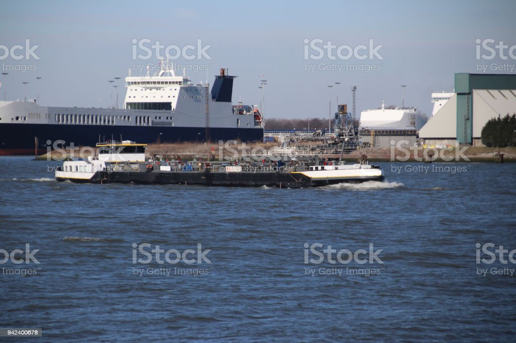 Ferry and inland ships in the water of the port of Rotterdam the Netherlands stock photo