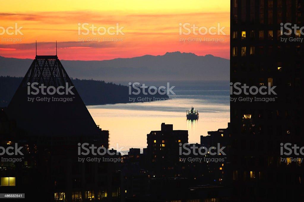 Ferry at dusk stock photo