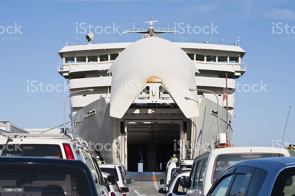 Ferry at the port ready for boarding of cars stock photo