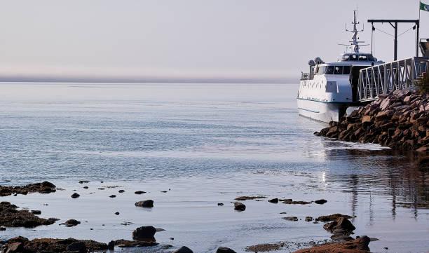 A ferry awaits the cars. stock photo