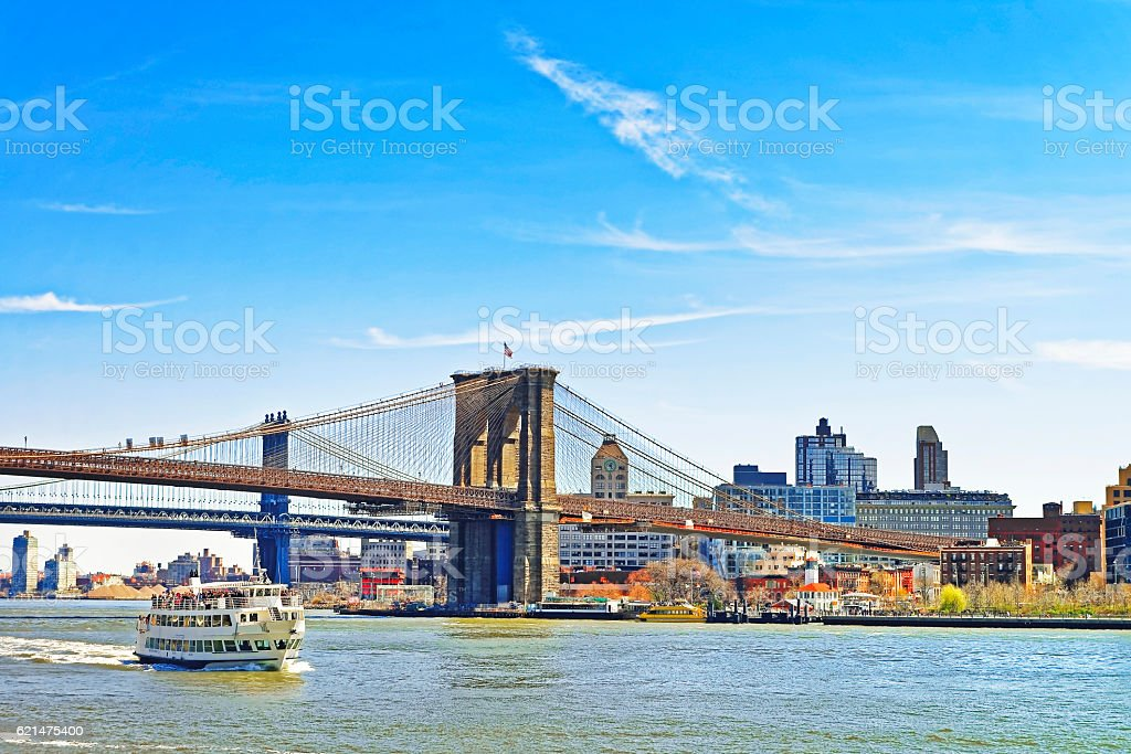 Ferry boat and Brooklyn bridge across East River stock photo