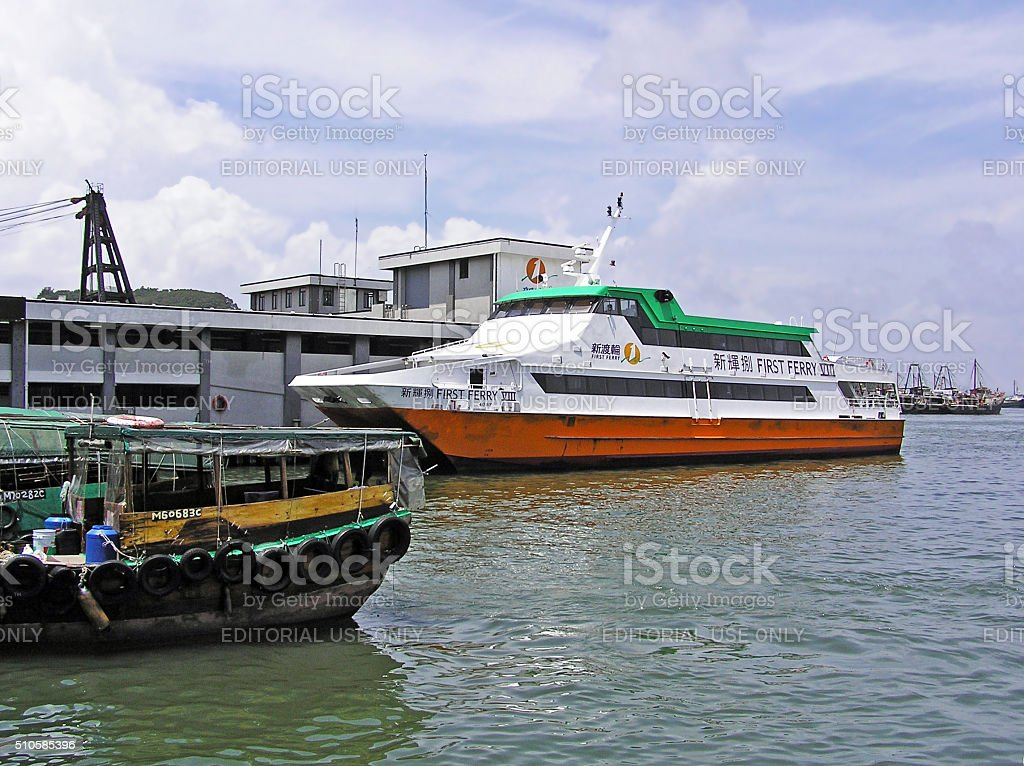 Ferry boat at the pier in Cheung Chau stock photo