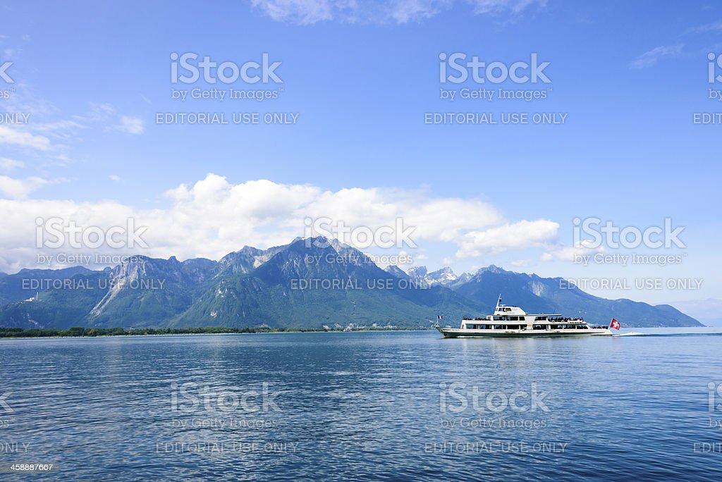 Ferry boat crosses Lake Geneva between Switzerland and France royalty-free stock photo