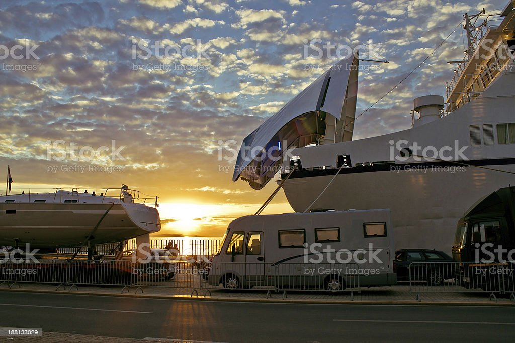 Ferry boat docks at sunset royalty-free stock photo