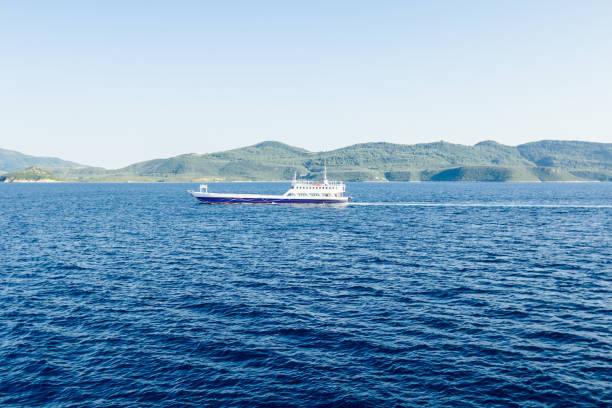 ferry boat is in transport, passing over sea - defection stock photos and pictures