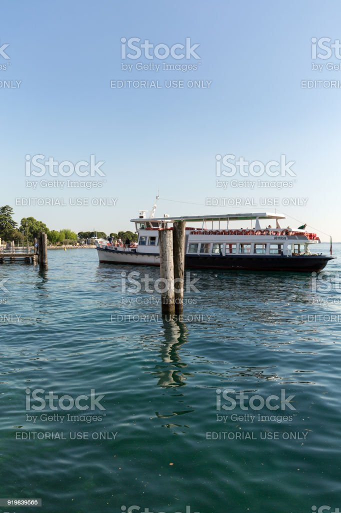 Ferry boat on  Lake Garda. Garda Lake is one of the most frequented tourist regions of Italy. stock photo