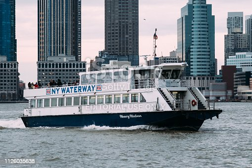New York City, USA -January 27, 2019: Ferry boat on The Hudson River. Ferry features service that connects Manhattan with Jersey City.