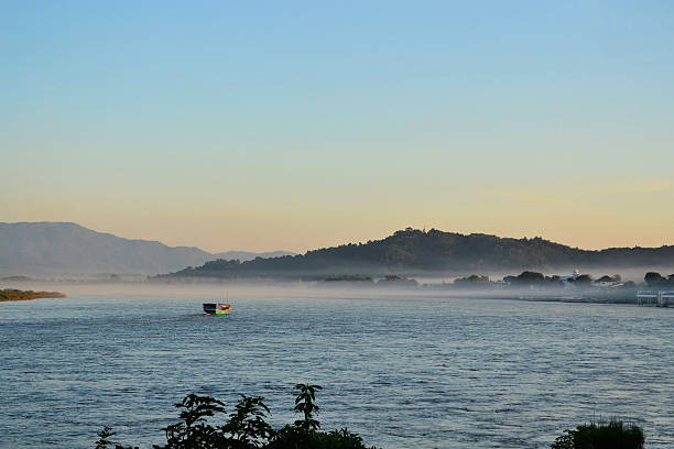 Ferry boat on the Mekong between Thailand and Laos stock photo