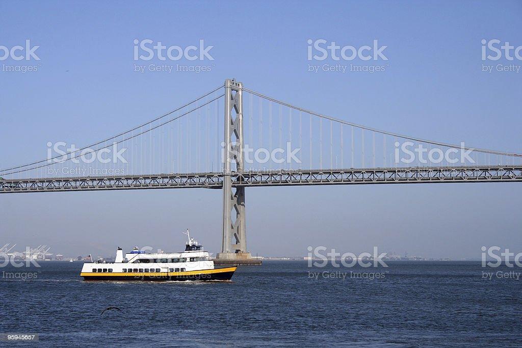 Ferry Boat Passing San Francisco Bay Bridge royalty-free stock photo