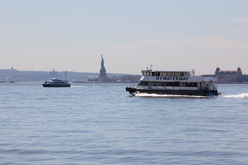 Ferry Boats And The Statue Of Liberty Stock Photo More