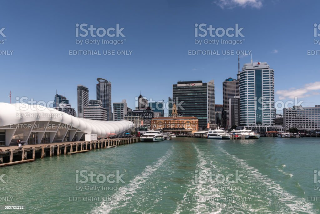 Ferry Building and Auckland skyline under blue sky. stock photo