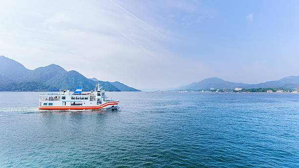Ferry crossing the inland sea between Miyajimaguchi and Miyajima island Ferry crossing the inland sea between Miyajimaguchi and Miyajima island , destination tItsukushima shrine , Hiroshima , Japan hiroshima prefecture stock pictures, royalty-free photos & images