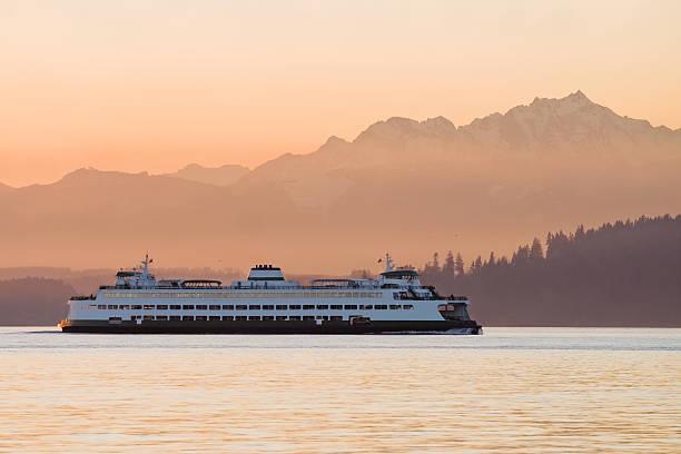 a ferry crossing waters at sunset - veerboot stockfoto's en -beelden