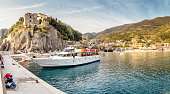 CINQUETERRE, ITALY, OCTOBER 15, 2018: Ferry cruise boat with tourists sailing in Cinque Terre national park in the Mediterranean or Ligurian Sea