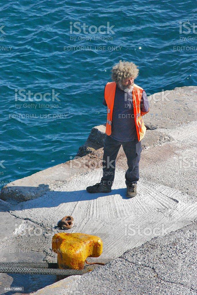 Ferry dock worker in Naxos, Greece stock photo