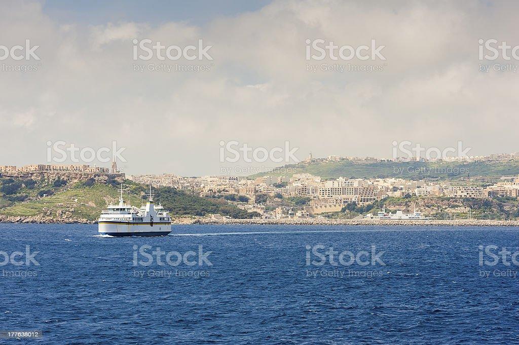 Ferry leaving Gozo island royalty-free stock photo