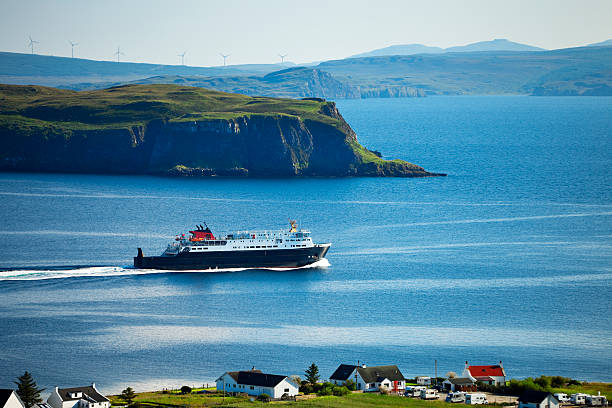 Ferry  Leaving Uig on Isle of Skye , Inner Hebrides, Scotland Ferry Caledonian MacBrayne`s leaving Uig on Isle of Skye for Tarbert on Isle of Harris, Inner Hebrides, Scotland, United Kingdom, Europe, isle of skye stock pictures, royalty-free photos & images