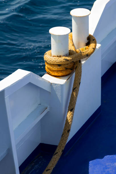 Ferry Metal Bollard and Mooring Rope stock photo