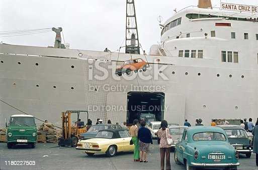 Gran Canaria, Canary Islands, Spain, 1972. Ferry on Gran Canaria loads cars in the ship's hull: Also: tourists, passenger and crew.
