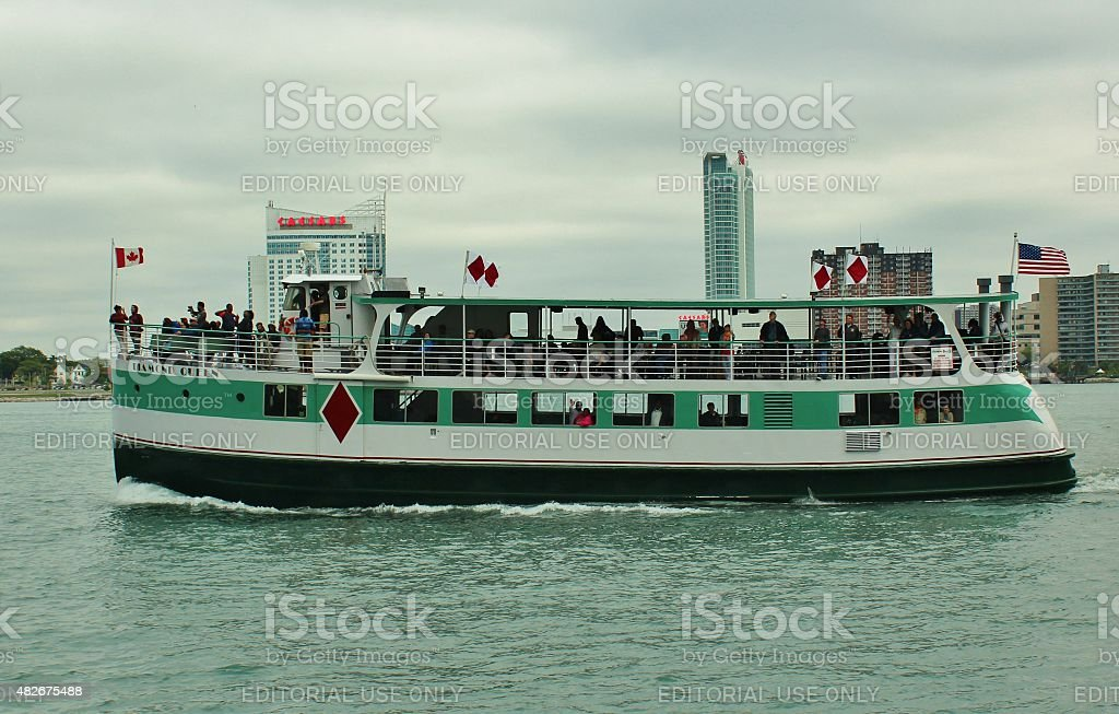 Ferry on the Detroit River displaying American and Canadian flags stock photo