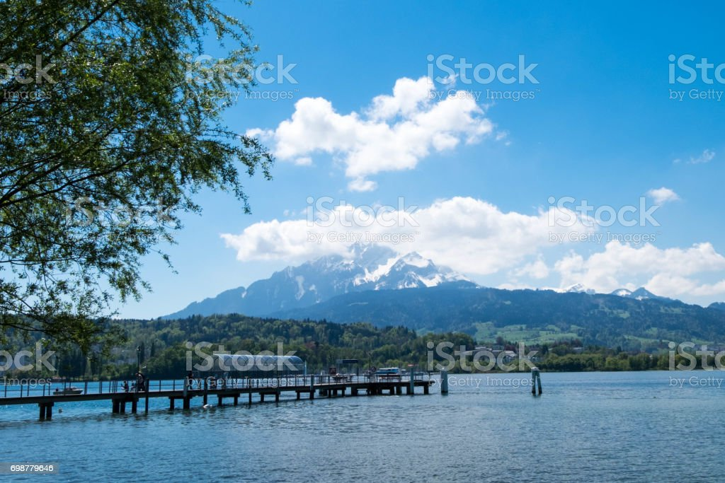 Ferry port at Lucern park which there is mountain as background. stock photo
