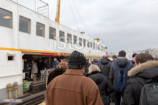 Kadikoy, Istanbul - Dec 21, 2018: People are getting inside the boat in Kadikoy ferry port.