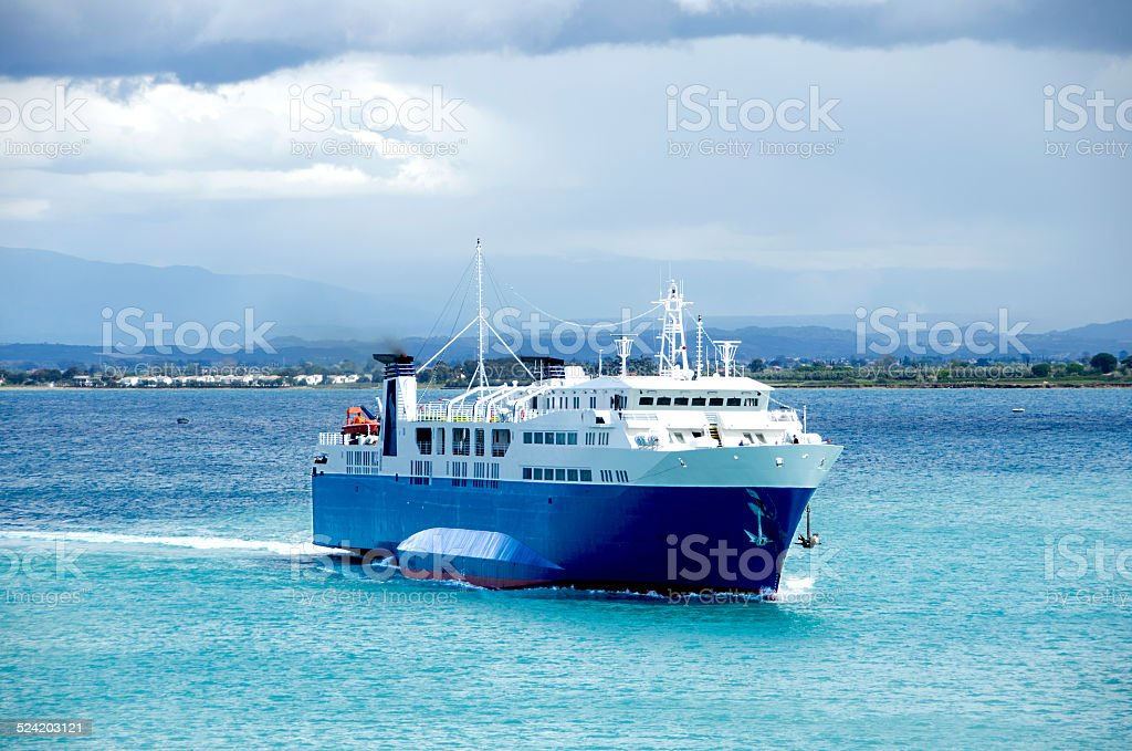 Ferry returning to port stock photo