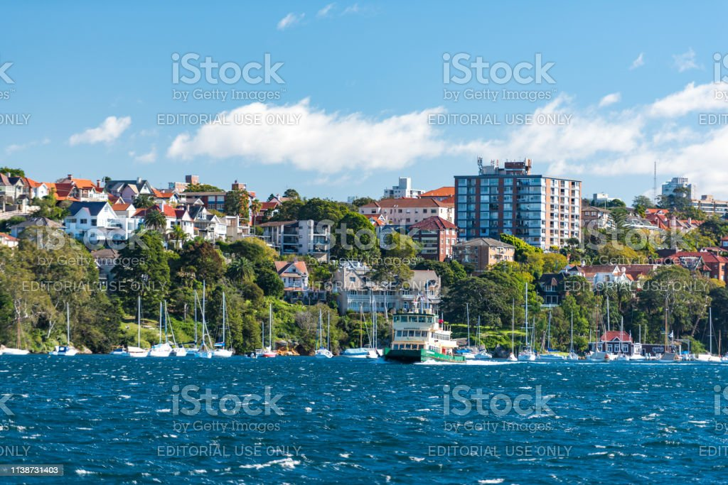 Ferry riding the Sydney Harbour in Cremorne Point suburb of Sydney stock photo