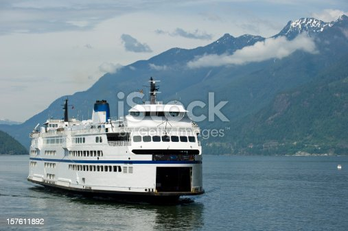 istock A ferry sailing through a waterway surrounded by hills 157611892
