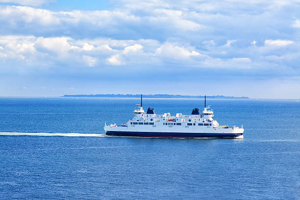 ferry sailing through the sound, seen from kronborg castle - veerboot stockfoto's en -beelden