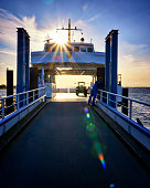 Ferry with tractor at the Baltic Sea coast in the sunshine. Germany