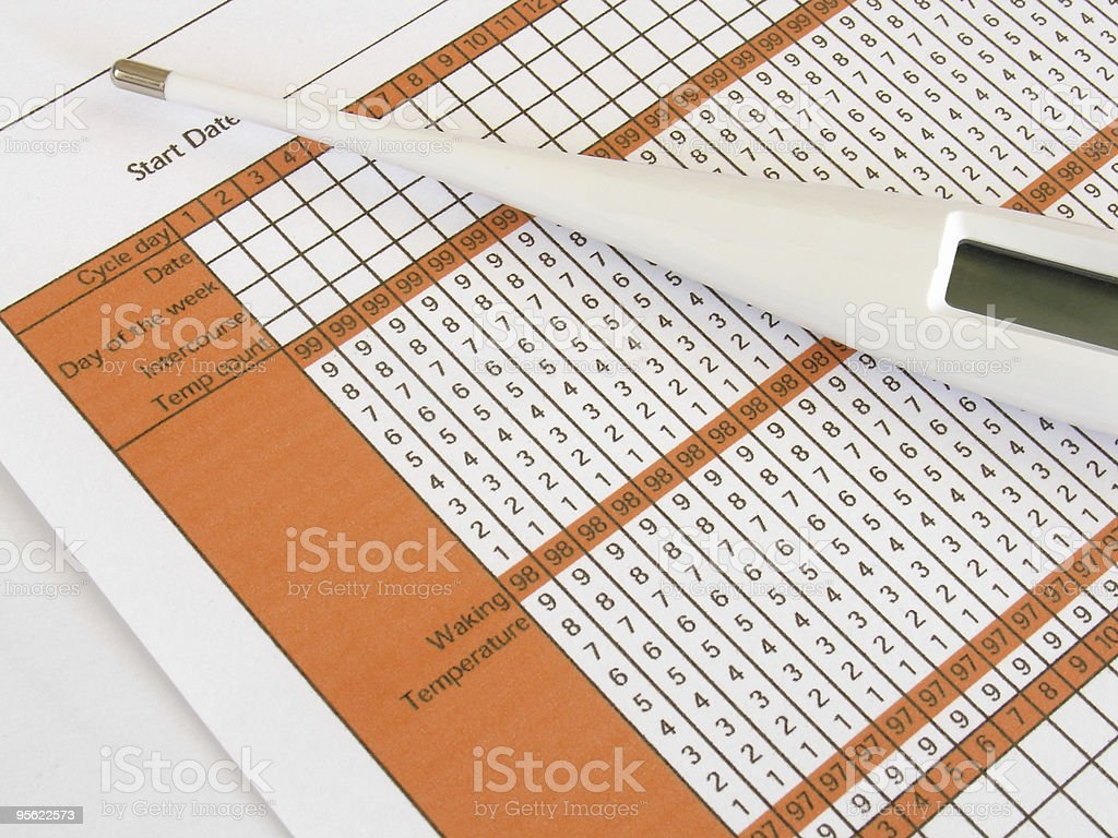 Fertility chart along with a white pregnancy test stock photo
