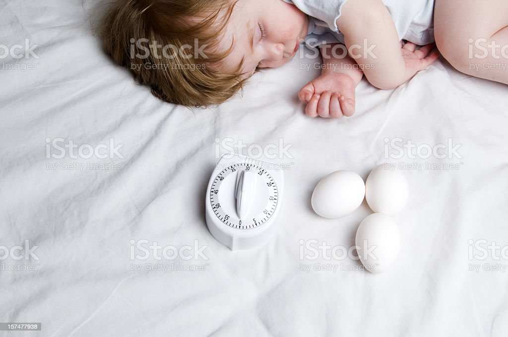 Fertility Concept, Baby, Eggs and Timer stock photo
