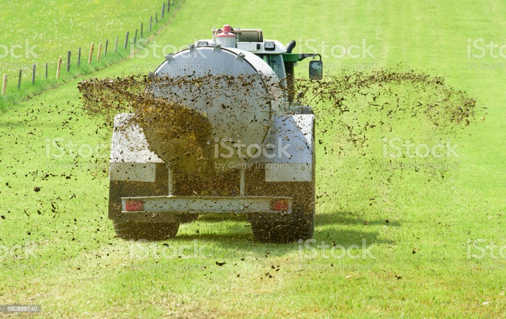 fertilization with tractor and liquid manure in Bavaria, Germany stock photo