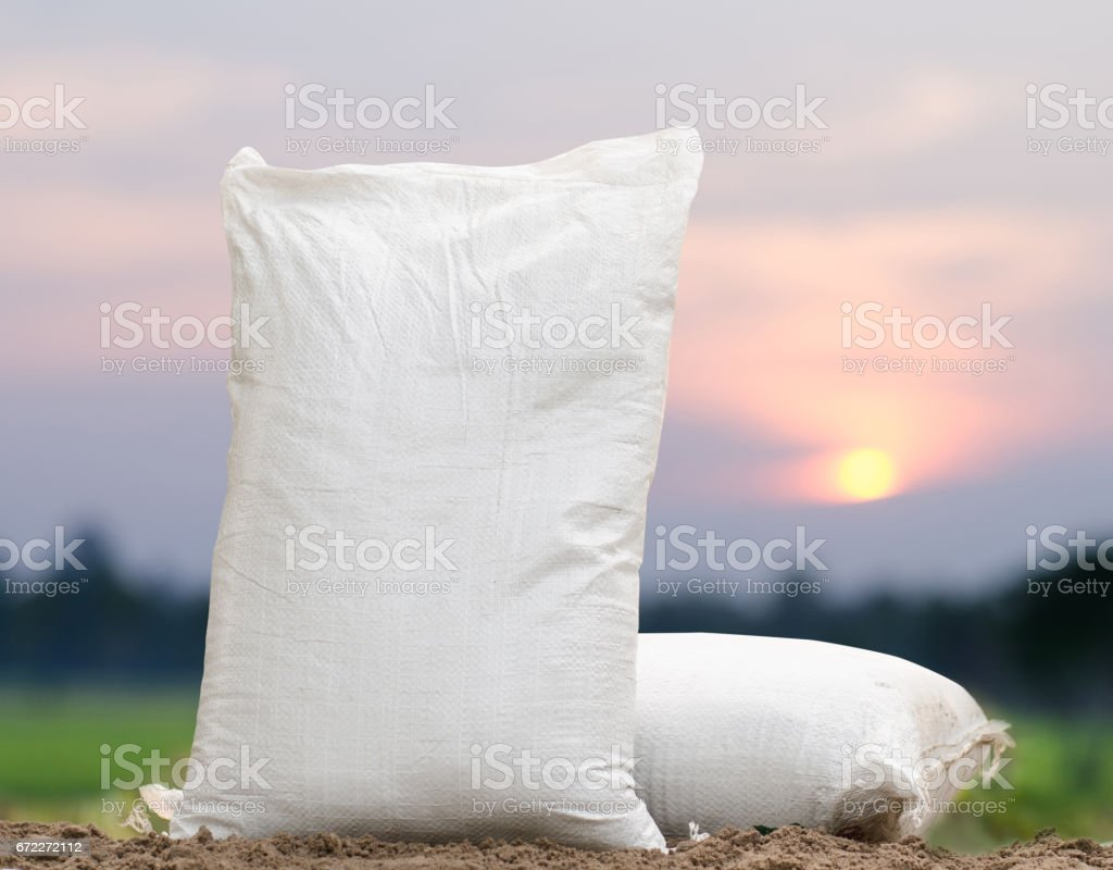 Fertilizer bag over sunrise stock photo