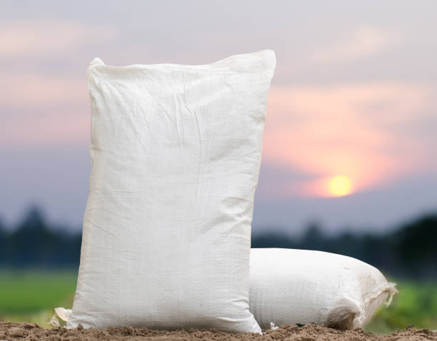 fertilizer bag over sunrise - sack stock pictures, royalty-free photos & images