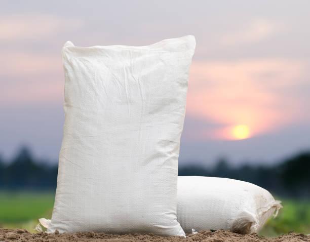 Fertilizer bag over sunrise stock photo