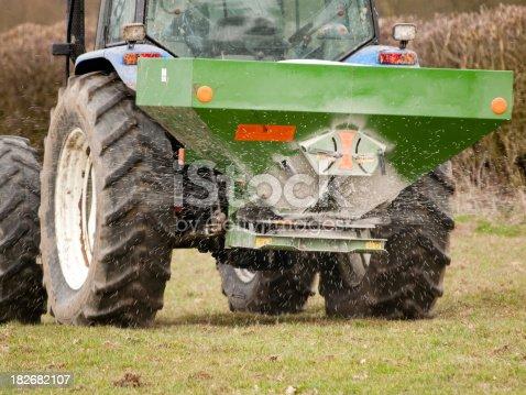 Spreading  non organic fertilizer. NB Not John Deere equipment