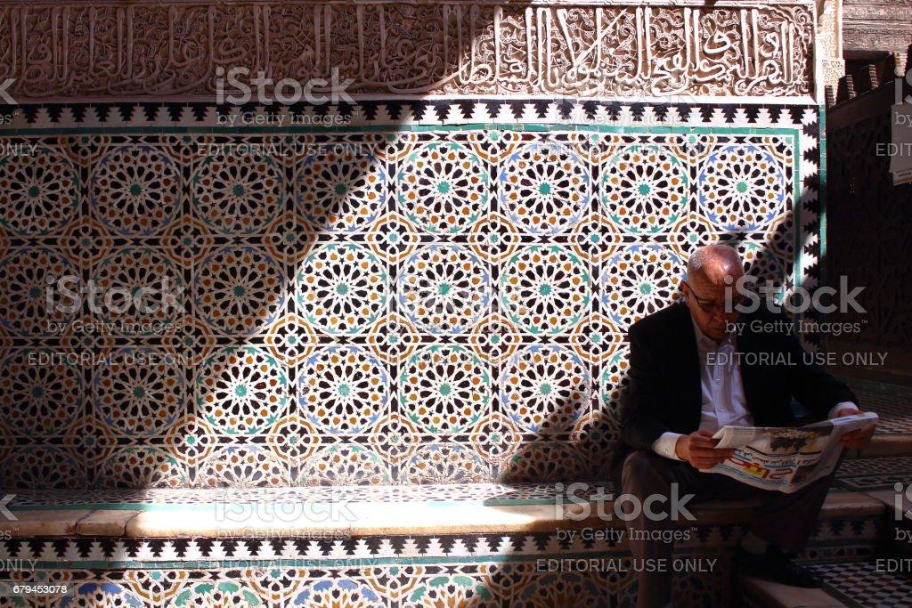 Fes, Morocco - MAR 06th, 2017: A man reading nesws paper stock photo