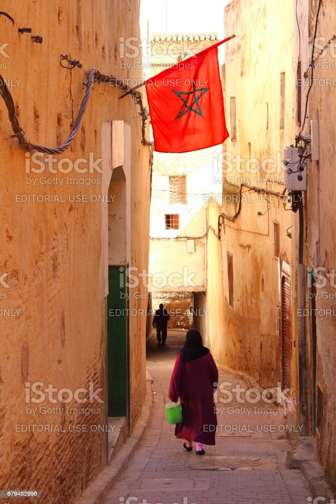 Fes, Morocco - MAR 07th 2017: A woman walking allyway stock photo