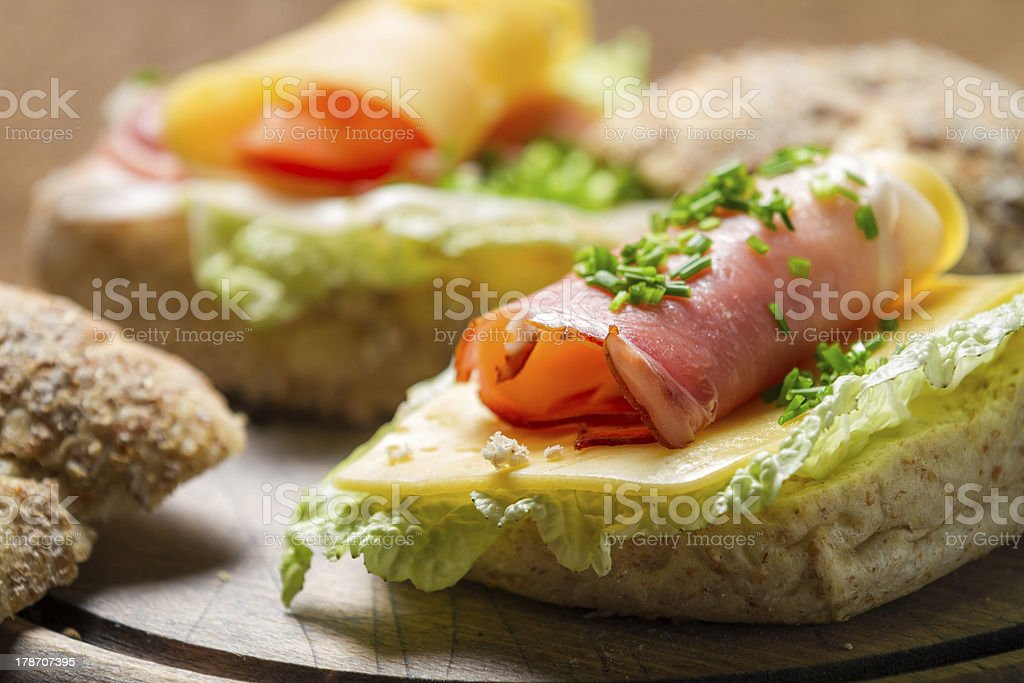 Fesh sandwich made of chive, ham lettuce and cheese royalty-free stock photo