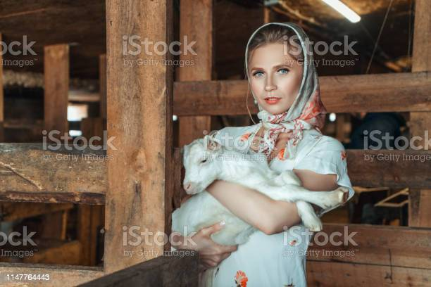 Feshion woman on the farm holding a little goat in her arms picture id1147764443?b=1&k=6&m=1147764443&s=612x612&h=hlyhkjjzpb4paxlt3z2l 22rn4zscron1hixmeln1ii=