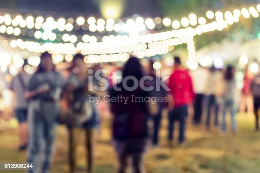 613897214istockphoto Festival Event Party Blurred People Background 613906244