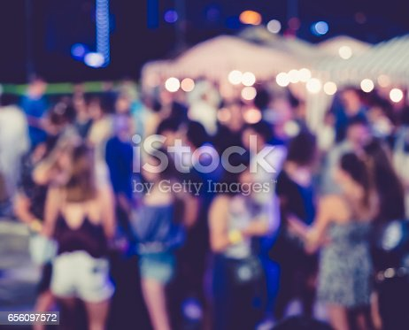 613897214istockphoto Festival Event Party outdoor with Blurred People 656097572
