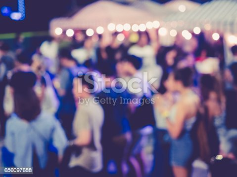 860440036 istock photo Festival Event Party outdoor with Blurred People 656097688