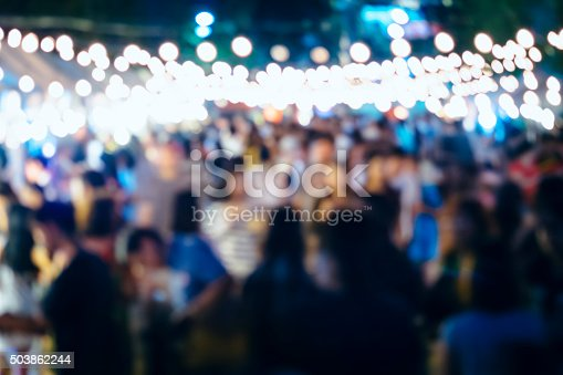 860440036 istock photo Festival Event Party with Blurred People Background 503862244