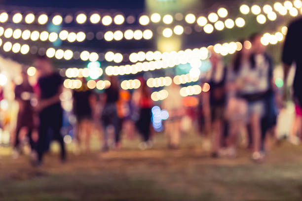 festival event party with blurred people background - circus background stock photos and pictures