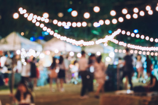 istock Festival Event Party with Hipster People Blurred Background 613897214